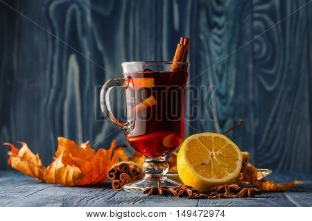 Mulled Wine In Glass Mugs With Spices And Pear Fruits. Autumn Still Life. Vintage Stylized