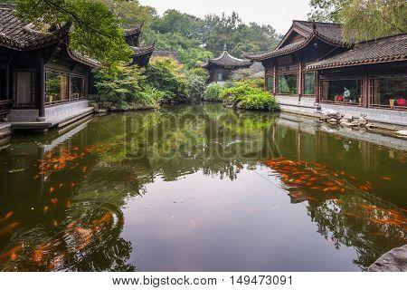 Hangzhou China - October 24 2013: Pond and fish koi in classic chinese garden Hangzhou China.