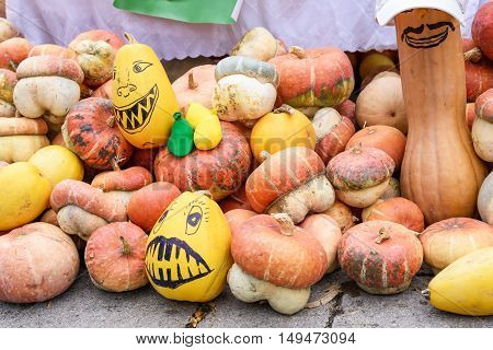Pile of pumpkins drawn as monsters at harvest festival in Moldova
