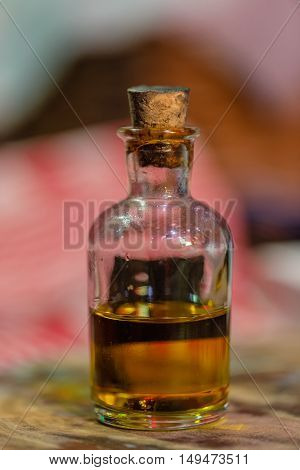 Small glass bottle with vegetable oil inside