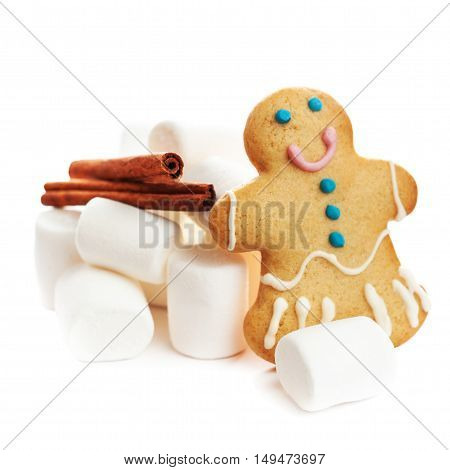 Gingerbread man cookie and white marshmallow isolated on white background. Holiday Christmas concept