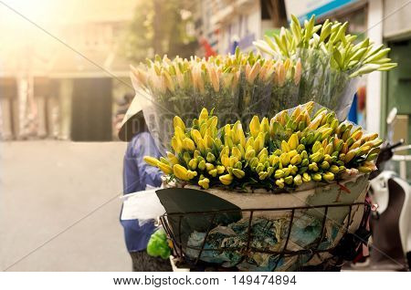 florist vendor selling flowers in the morning with light flare