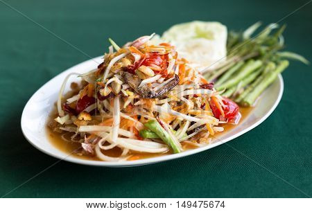 Papaya Salad Thai style (Som tum ) serve with fresh grees vegetable