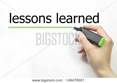 Hand writing lessons learned with marker on transparent wipe board.