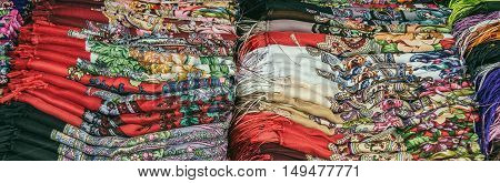 Multi colored fabric. Fabric shop. Selective focus