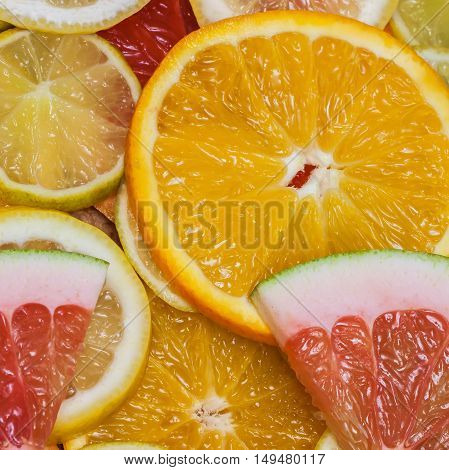 Fresh juicy colorful slices of citrus. Healthy eating, diet, vitamins, natural background, square