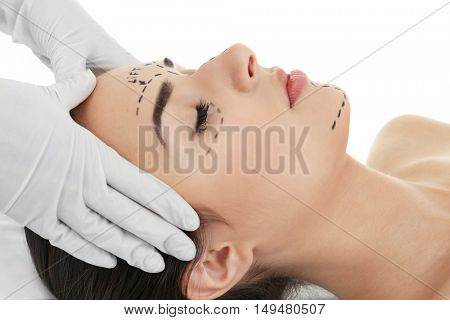 Plastic surgery concept. Specialist checking female face