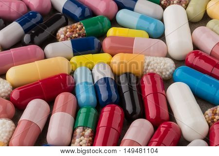 Various colorful medical pills and capsules closeup