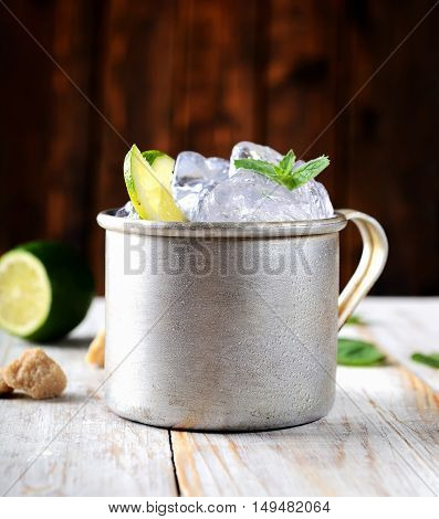 cold mojito in the vintage mug, lime, mint, ice and brown sugar