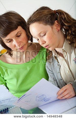 Girl Doing Homework With Her Mom