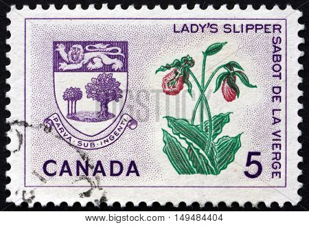 CANADA - CIRCA 1965: a stamp printed in the Canada shows Lady's Slipper and Arms of Prince Edward Island circa 1965