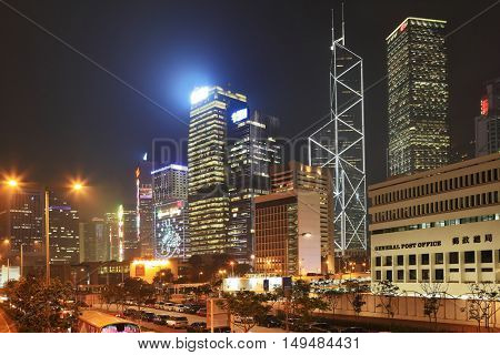 HONG KONG - DECEMBER 12, 2014: Hong Kong Special Administrative Region. Cars drew fiery strips.  Night city lights up with millions of lights