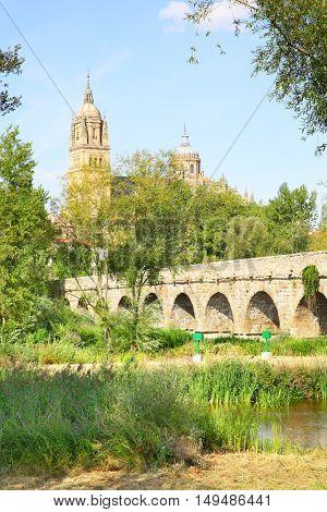 Park near Roman bridge in Salamanca, Spain
