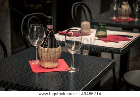 Wine bottle and glasses at a cafe in florence