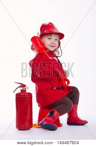 photo of little funny firefighter on white background