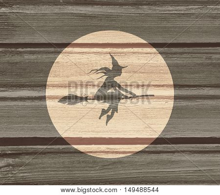 Illustration of flying young witch icon. Witch silhouette on a broomstick. Halloween relative image. Wood texture