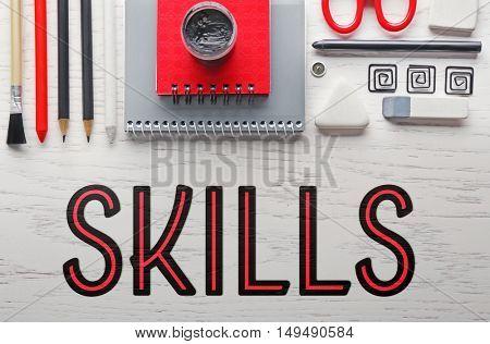 Skills. Office supplies on light wooden background