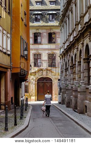Young Woman Walking Along The Street, Strasbourg, Old Center