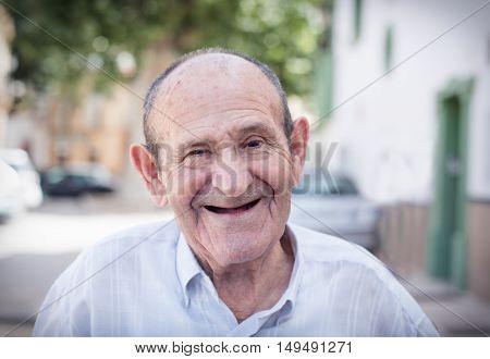 Happy smiling 78 year old elder senior man portrait