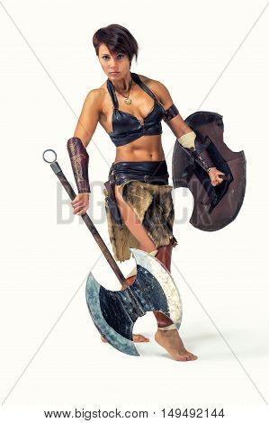 Beautiful strong woman in the image of the warrior of the ancient world on white background.