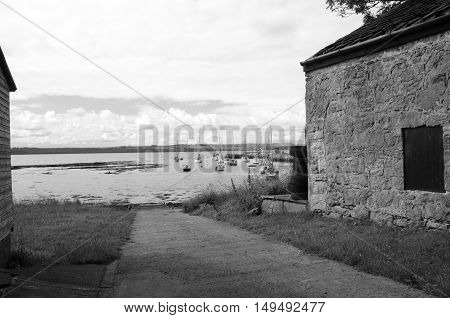 A view down a slipway toward moored boats at Limekilns