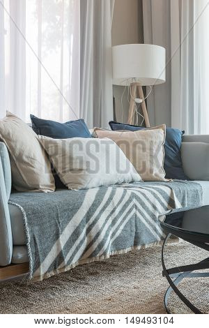 Set Of Pillows And Sofa With White Lamp In Modern Living Room