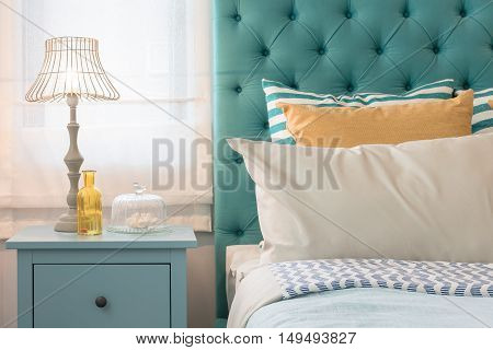 Modern Colorful Bedroom Design With Lamp On Blue Table
