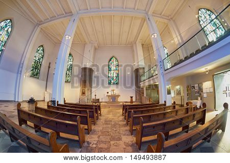 ESSEN, GERMANY - MARCH 07, 2016: Daylight shining into City Church that is empty