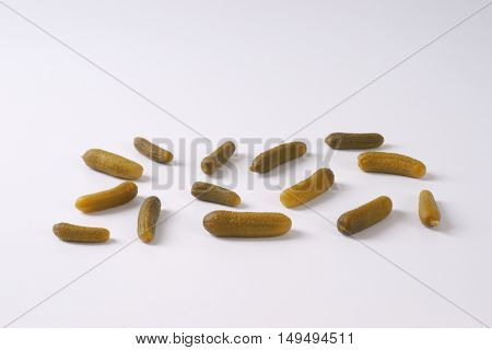 group of pickled cucumbers on white background