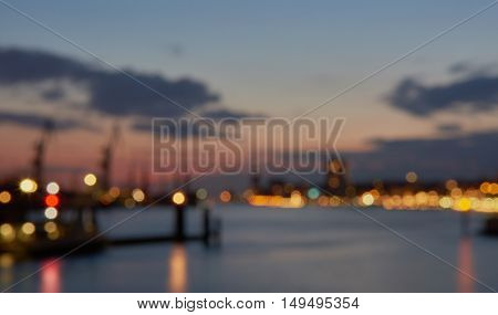 Bokeh Background with Blue Hour View on Harbor of Hamburg.