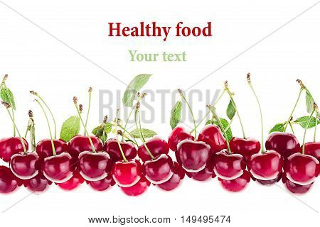 Cherry background. Bunches of ripe juicy rich shiny cherries on a white background. Isolated. Decorative fruit frame. Fresh ripe cherries with tails and leaves. Fruit background. Copy space.