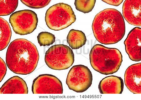 Slices of fresh figs on a white background. Isolated. Decorative food background.