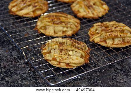 home baked apple pie cookies on cooling rack