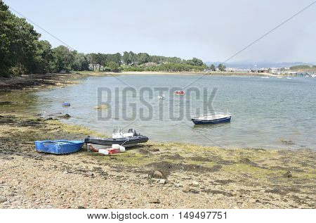 LA TOJA, SPAIN - AUGUST 8, 2016: Some boats in a beach od the Island of La Toja in the province of Pontevedra Galicia Spain.