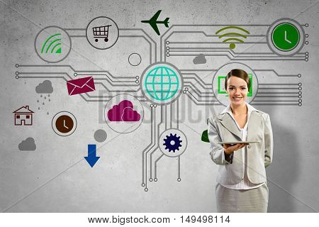 Businesswoman presenting tablet pc and color icons at background