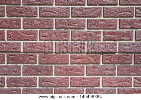 urban brick wall from a beautiful glossy bricks