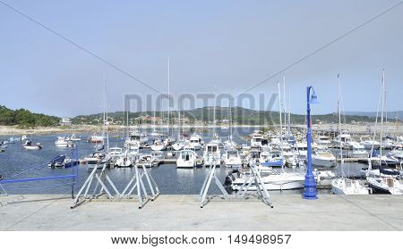 LA TOJA, SPAIN - AUGUST 8, 2016: Ships at Marina in the island of La Toja Galicia Spain.