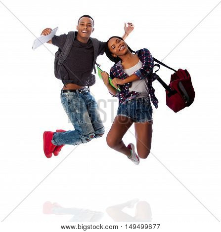Two Happy Students Jumping Of Happiness