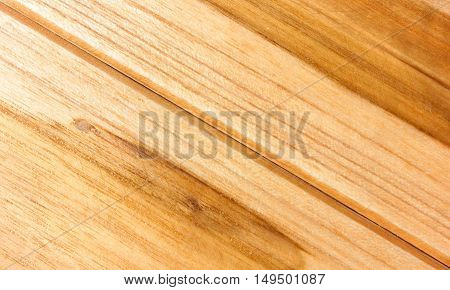 Slanted wooden brown table background, top view