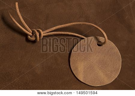 Leather label on a brown leather background