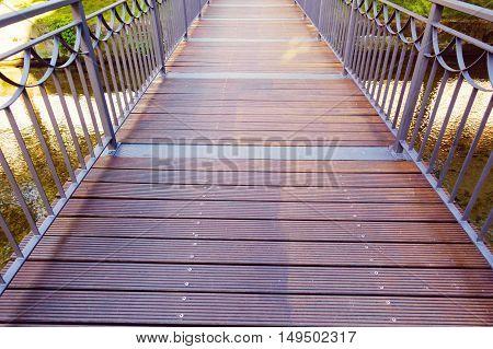Modern Wooden Bridge Through The River