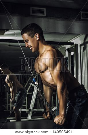 Sport. Strong athlete is going to do exercise with weight -- toned and stylized photo
