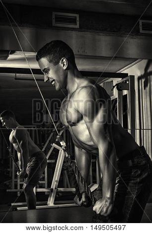 Sport. Strong athlete is going to do exercise with weight -- toned photo