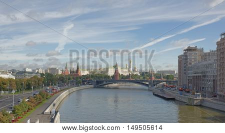 Moscow Russia -September 06 2016: View of the Kremlin from the Patriarchal bridge. On the waterfront are moving people and vehicles