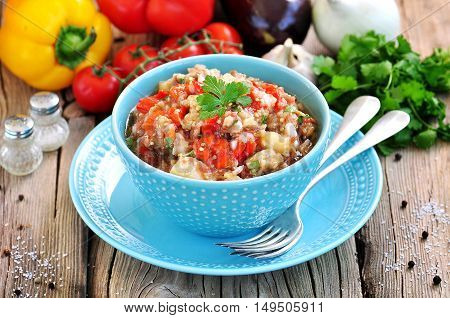 Appetizer (salad) of roasted eggplant, peppers, tomatoes, onions, garlic and coriander.