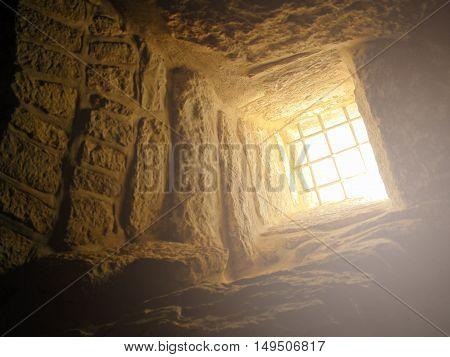 Bell Cave located at Israel. Photo taken from inside with ray of light falling from above.