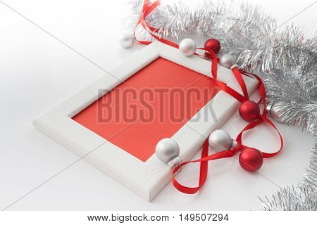 New Year and Christmas greeting card template made of white frame and red card with red ribbon silver and red balls and silver tinsel with copy space horizontal view