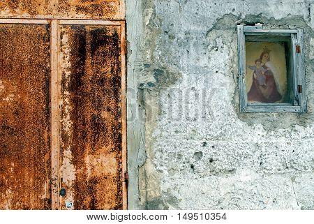 Matera, Italy- ancient wall, shrine and door