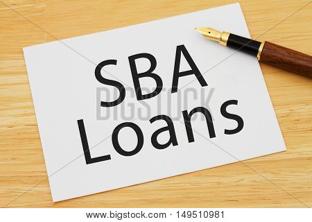Getting a SBA Loan A card and pen on a desk with text SBA Loan