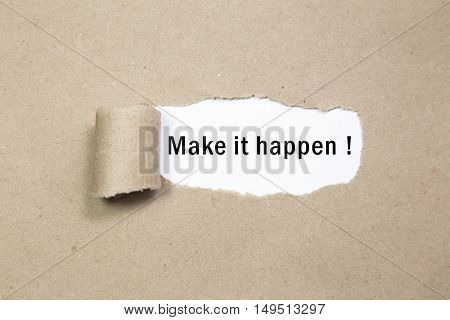 Make it happen! appearing behind torn brown paper.